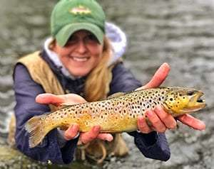 woman angler with brown trout provided by DEC
