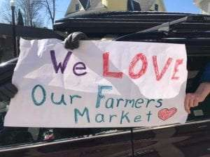 Sign seen during curbside pick-up at the Saranac Lake Farmers' Park It - Adirondack Harvest