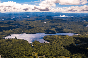 Salmon Lake stands in the foreground, part of the Whitney tract, with Rock Lake and Little Tupper Lake in the background