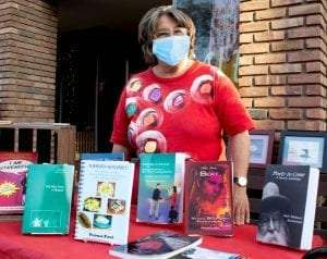 Yvona Fast with some of her books and photos