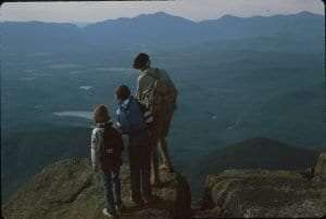 Alpine climber John Case speaks of the landscape below Whiteface Mountain to children from the area, c. 1978.