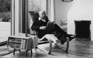 Jack Pritchard in Marcel Breuers long chair and Risss Donkey bookcase