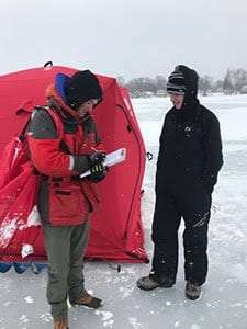 DEC Fisheries staff conductiong ice fishing surveys