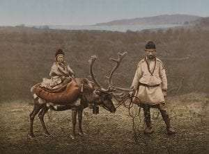 Sami people with reindeer