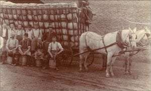 Fredricksons Cooperage esterford with workers and horses near full of barrells wagon