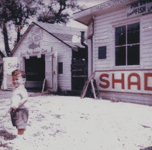 young boy in the front of Shantytown courtesy the Leo Bower Collection