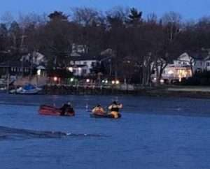 ECO Macropoulos and local fire departments in Manhasset Bay observing dolphin