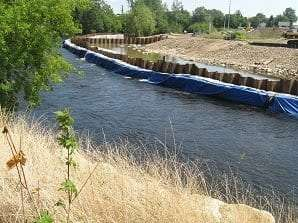 river being protected while coal tar is being removed from sediment by Mary Jo Crance
