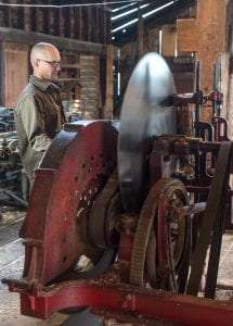 Mill Manager Rob Dianach operating the water-powered Chase shingle mill at Hanford Mills Museum