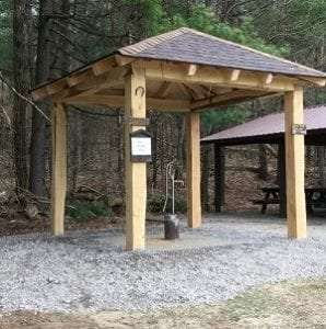 new well pump and the covered structure that houses it