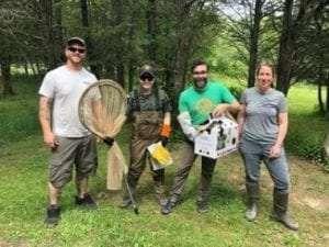 Volunteer Jason Ramey, ECO DuChene, Volunteer Jeff Rossi, Head Keeper Melissa Gillmer after a successful great blue heron rescue