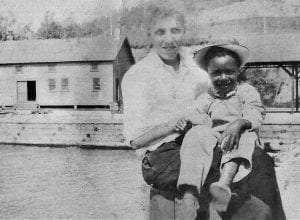 Unidentified man and child at Baldwin Docks, Ticonderoga. Ticonderoga Historical Society Collection
