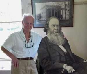 Norman K Dann PhD poses with Gerrit Smith exhibit