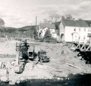 A temporary bridge was constructed during the replacement of the bridge in the Poestenkill Village in the 20th century. Courtesy Poestenkill Historical Society.