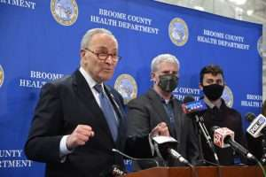 Senate Majority Leader Chuck Schumer (far left) with Michael Grasso, Executive Director of the Roberson Museum and Science Center (far right) at a press conference in Binghamton