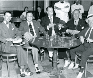 """""""Killer"""" Madden (at far left), notorious underworld figure, enjoys a laugh with a few of his pals in the dining room of the Grand Union Hotel in Saratoga Springs"""