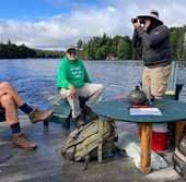 8. Noel Sherry ferrying Twitchell guests to East Pond trailhead on his dock, taken by Ingelise Sherry