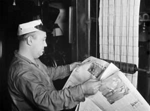A New York Times pressman checking a newspaper for defects in 1942