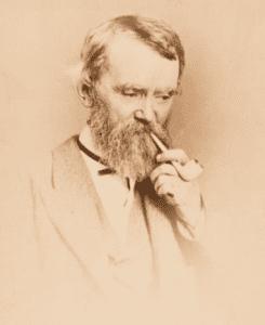 Henry Clapp smoking his trademark clay Parisian pipe