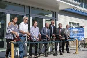DEC, State Parks, and Suffolk County officials cutting the ribbon at DEC Marine Resources Headquarters